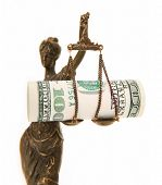 A picture of a Themis statue with dollar notes on the scale as a symbol of corruption over white bac