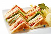 picture of crisps  - Chicken club sandwiches with potato crisps and dill pickles - JPG