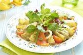 Potato salad with smoked sea bass and salmon