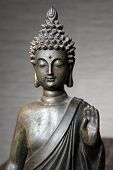 picture of metal sculpture  - Metal Asian statue of Buddha with his hand raised giving a blessing - JPG