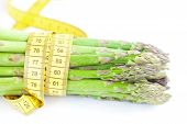 Bunch Of Asparagus Tied With Measuring Tape Isolated On White