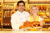 stock photo of pretzels  - Shopkeeper and baker in Bakery or baker - JPG