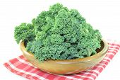 Kale In A Wood Bowl On Napkin
