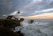 picture of home addition  - Dramatic Shot of the Portland Head Lighthouse. Picture taken at sunset. With the waves crashing on the rocks, and the lighthouse, this fine photograph makes a beautiful addition to any home or office.