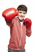 Young Teenage Boy Wearing Boxing Gloves Smiling