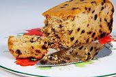 Sultana sponge cake and knife.