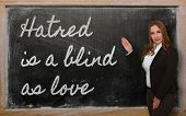 Teacher Showing Hatred Is A Blind As Love On Blackboard