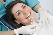 stock photo of denture  - A dentist showing porcelain teeth to pacient - JPG