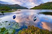 stock photo of ireland  - Boats on water in Killarney National Park Republic of Ireland Europe - JPG