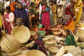 pic of barter  - People buying baskets from a crowded outdoor market in Orchha Madhya Pradesh India - JPG