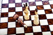 Brown and white Chessboard With Decorative wood Chessmen