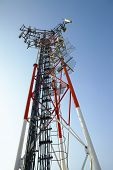 GSM transmitter tower against blue sky