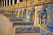 Famous ceramic benches in Plaza de Espana, Seville, Spain. Avila theme art.