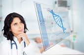 stock photo of ward  - Doctor studying virtual screen showing DNA helix in hospital ward - JPG