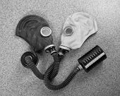 Loving couple of gas masks looking at each other