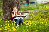 Teengirl in the park with books.