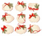 Set of beautiful christmas gift cards with red gift bows with ribbons Vector