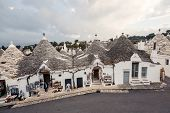 foto of conic  - Typical trulli houses with conical roof in unesco world heritage Alberobello - JPG
