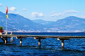 Bridge Across Okanagan Lake With Flags
