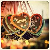 Retro effect image of Gingerbread hearts hanging in a German Christmas market. The prominent heart i