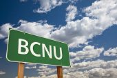 BCNU, Texting Abbreviation for Be Seeing You, Green Road Sign with Dramatic Sky and Clouds.