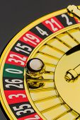 the cylinder of a roulette gambling in a casino. winning or losing is decided by chance. number zero