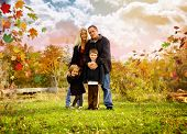 Happy Fall Family Outside With Leaves