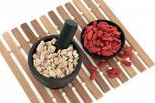 Chinese herbal medicine of ginseng and wolfberry fruit. Panax schinsen, ren shen, gou qi zi.