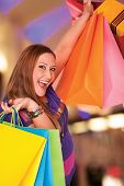 stock photo of xxl  - Happy xxl female holds shopping bags - JPG
