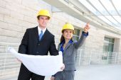 picture of team building  - An attractive diverse man and woman construction team at building site - JPG