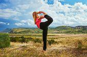 Slim Woman Do King Of Dance Yoga Pose