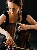 foto of cello  - Photo of a beautiful woman playing an old cello - JPG