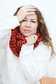 Illness Woman In Wool Scarf With Headache Holding Hands Behind Her Head