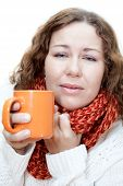 Young illness woman drinking tea with wrapping scarf on neck