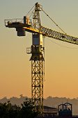 Big construction crane on resiodential construction site