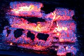 glowing embers from wooden briquettes.