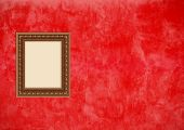 Grunge Red Stucco Wall With Empty Picture Frame