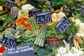 stock photo of stall  - Asparagus and vegetables at farmers market stall