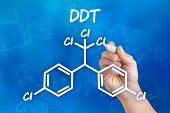 Hand with pen drawing the chemical formula of DDT