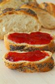 Challah slices with strawberry jam