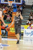 VALENCIA - MAY, 3: Raul Lopez drives the ball during a Spanish league match between Valencia Basket