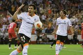 VALENCIA - MAY, 1: Parejo with ball and Piatti celebrate goal during UEFA Europe League semifinals match between Valencia CF and Sevilla FC at the Mestalla Stadium on May 1, 2014 in Valencia, Spain