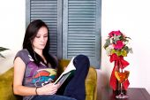 Cute Teen Girl Reading A Book