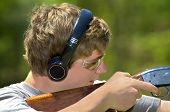 stock photo of shotgun  - A young teenager learning to shoot targets with a shotgun.