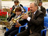 BUDYONNOVSK, STAVROPOL REGION, RUSSIA - MAY 1, 2014: trumpeters from municipal brass band on the Labor Day celebration, on 1st of May 2014, in Budyonnovsk, Russia.