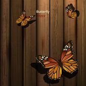 Wooden background with butterflies