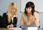 Blonde And Brunette Women In The Office