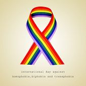 a rainbow ribbon and the sentence international day against homophobia, biphobia and transphobia