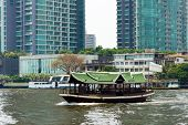 BANGKOK, THAILAND - MARCH 23: Tourists travel on the Chao Phraya river on a boat on March 23, 2014 i
