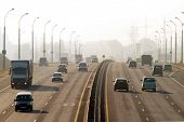 MINSK, BELARUS - NOVEMBER 3: Cars run down on ringway in thick smog November 3, 2011 in Minsk, Belar